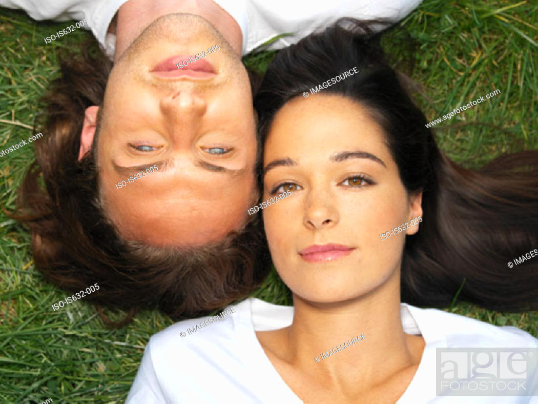 Stock Photo: Young couple resting on grass.