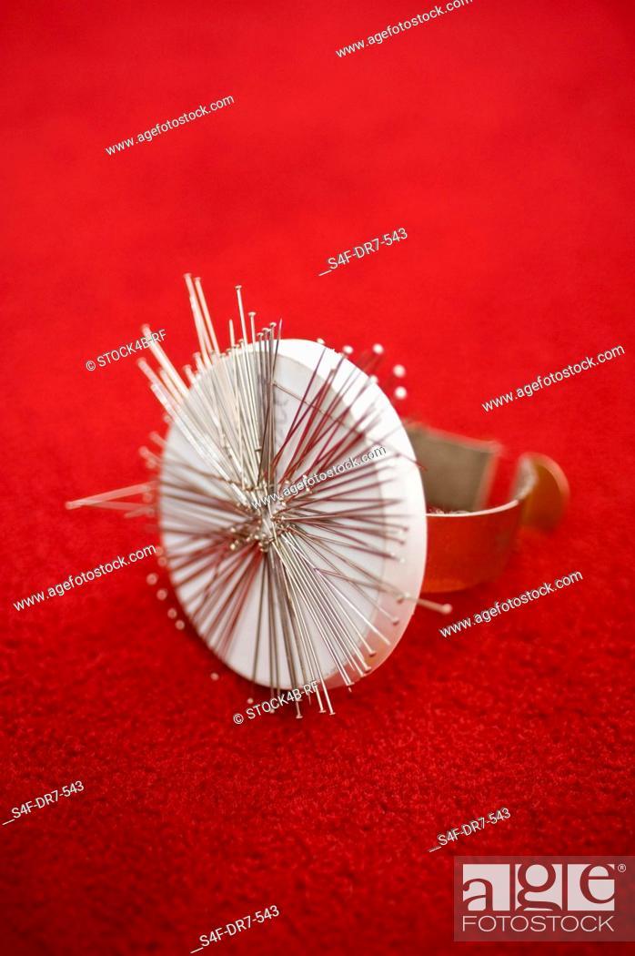 Stock Photo: Pin cushion with needles.