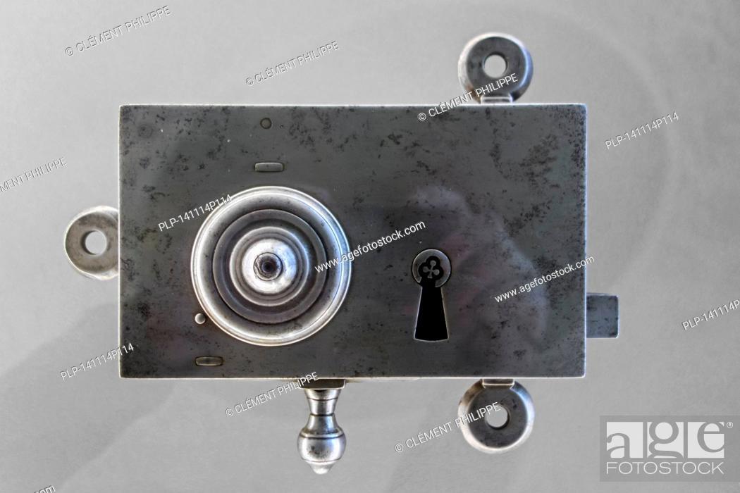 Photo de stock: Old 18th century metal door lock plate.