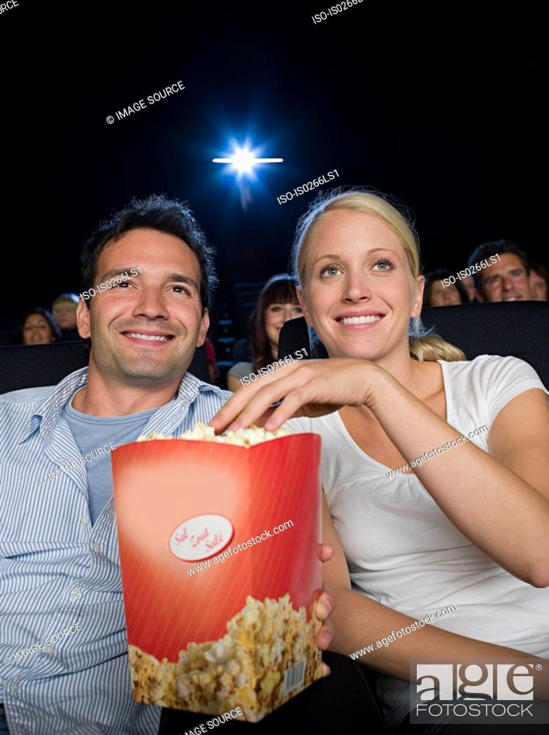 Stock Photo: A couple watching a movie.