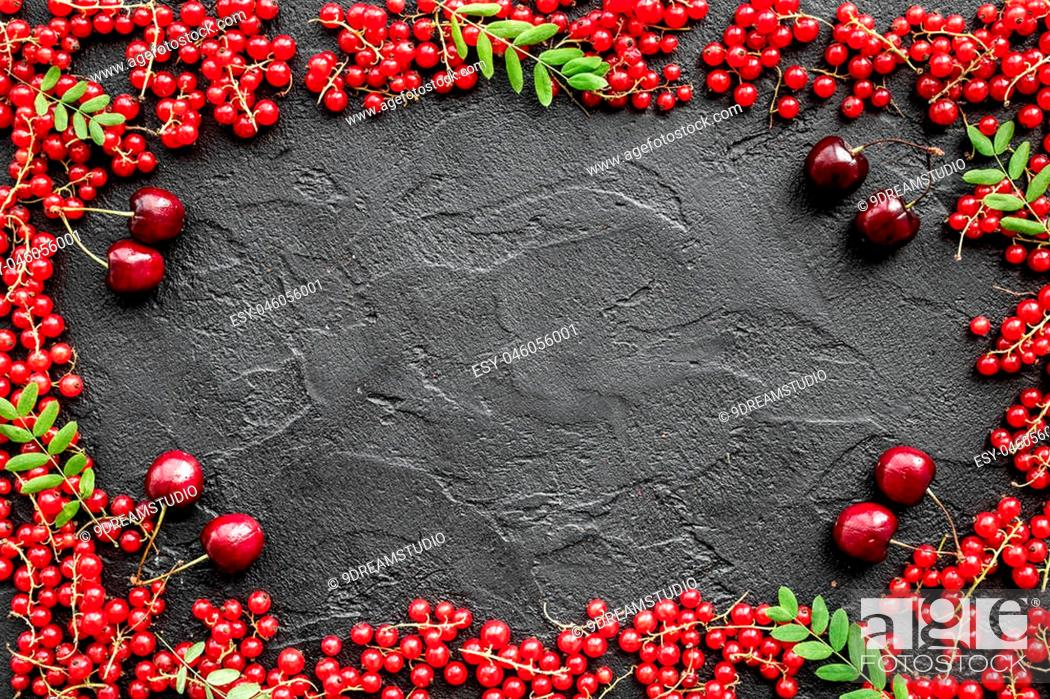 Stock Photo: Berry frame on balck table background top view.