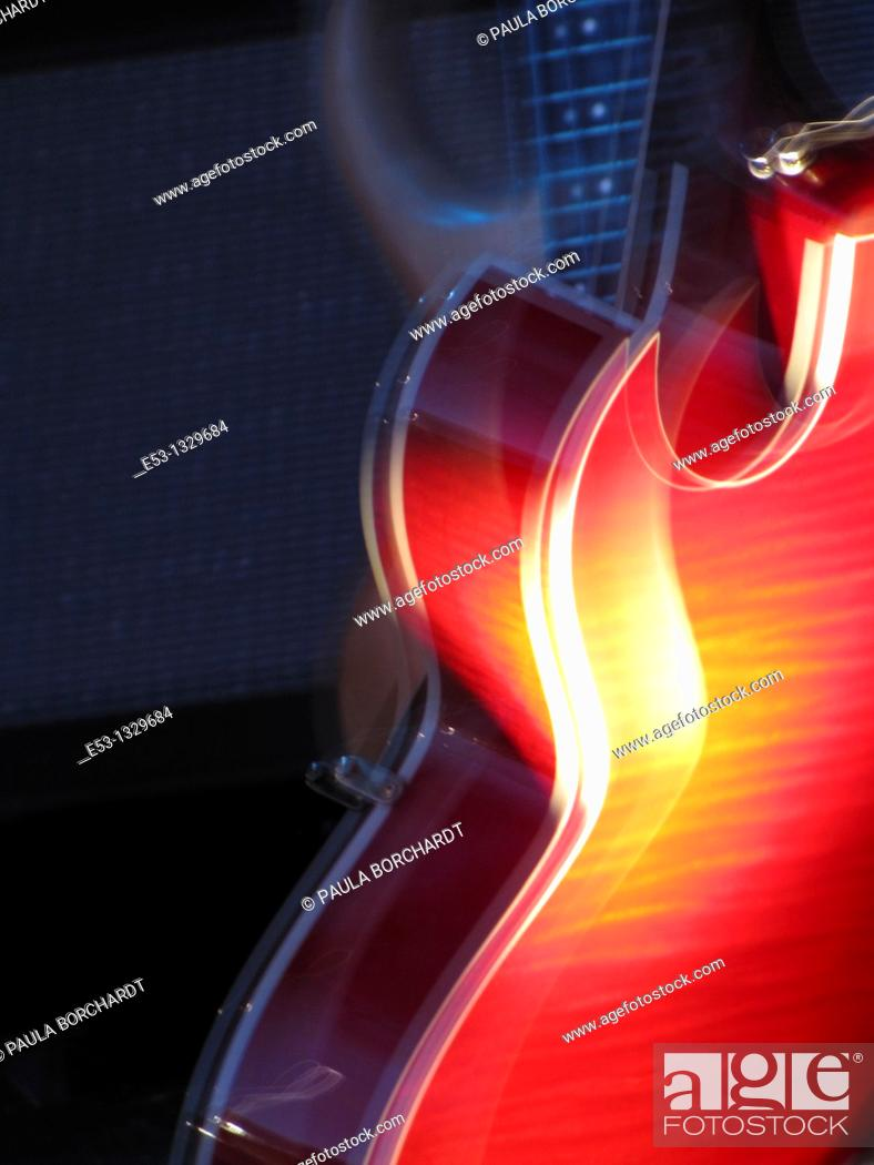Stock Photo: Electric guitar glowing red.