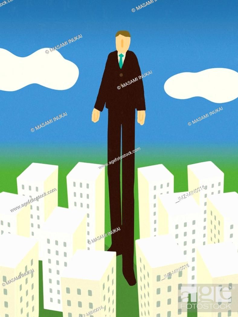 Stock Photo: A businessman taller than all the buildings in a city.