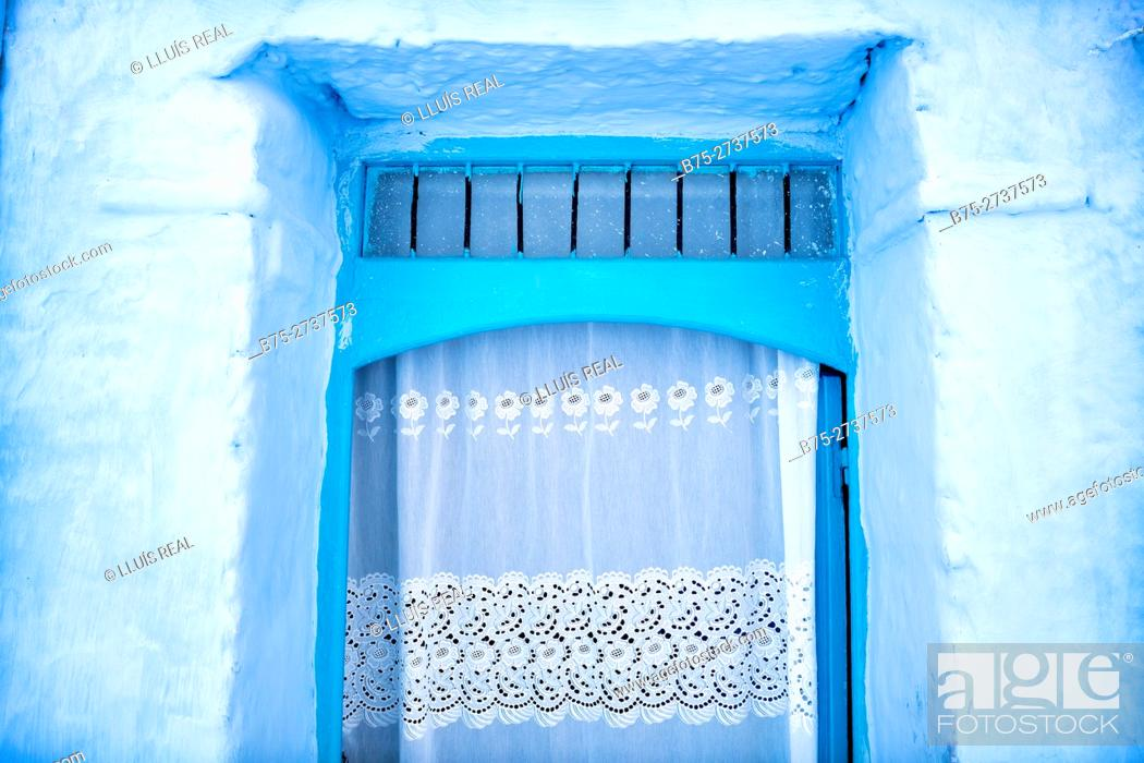 Stock Photo: Close-up of a door with a white curtain and blue walls. Chauen, Morocco.