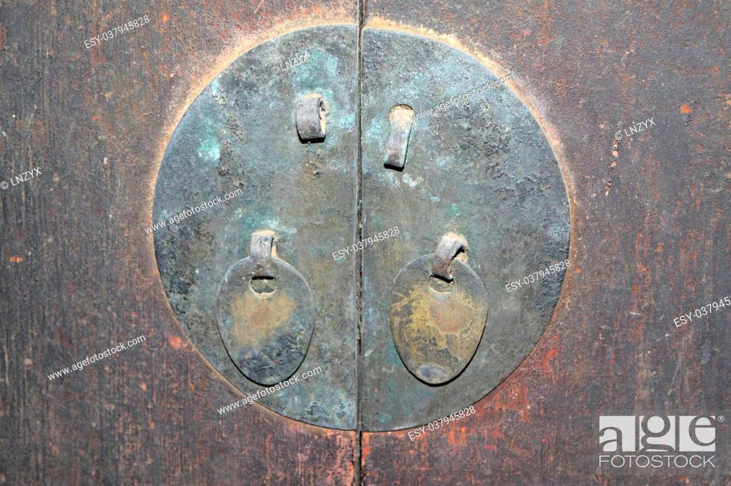 Stock Photo: metal decorations on a brown door.
