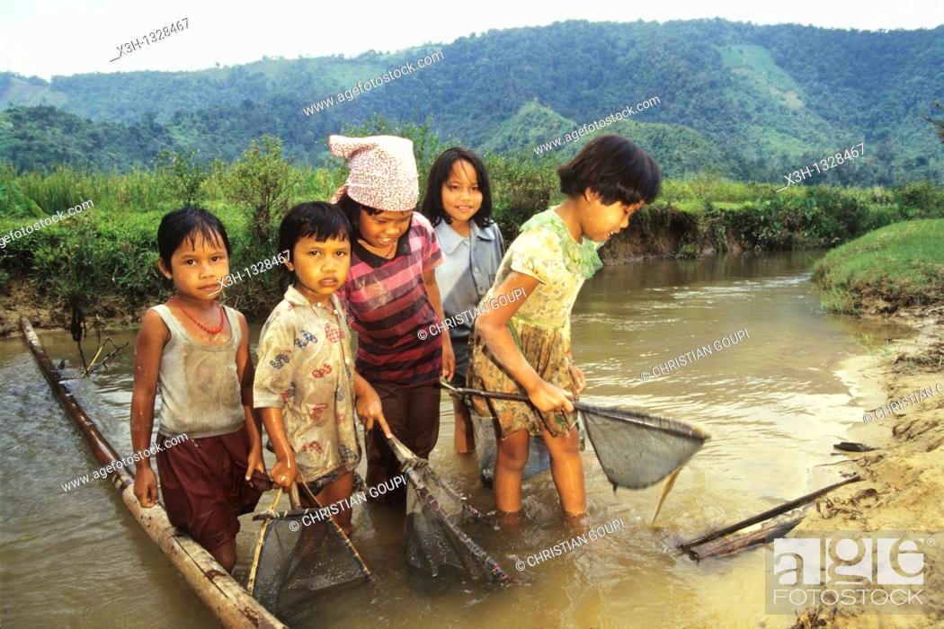 Stock Photo: children fishing with landing net in a river, Sumatra island, Republic of Indonesia, Southeast Asia and Oceania.