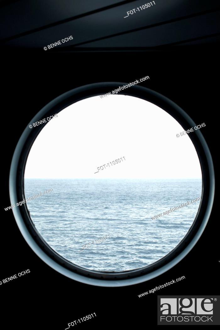 Stock Photo: View of the sea through a porthole.