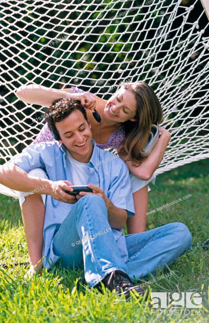 Stock Photo: couple in a hammock.