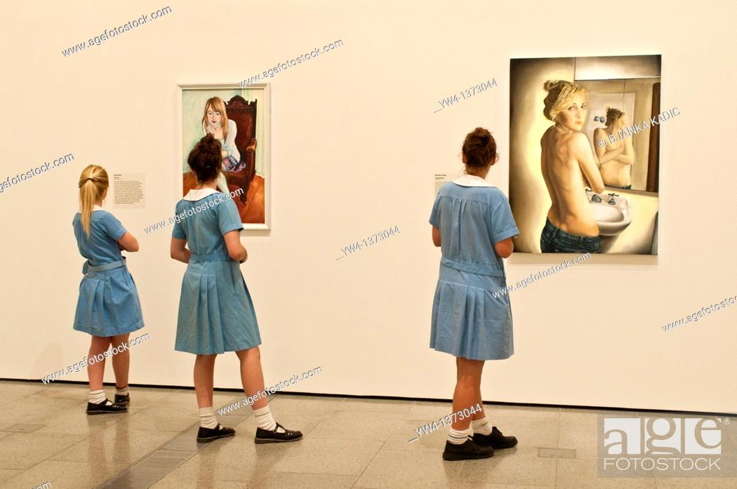 Stock Photo: National Gallery of Victoria, Schoolgirls looking at paintings, Melbourne, Victoria, Australia.
