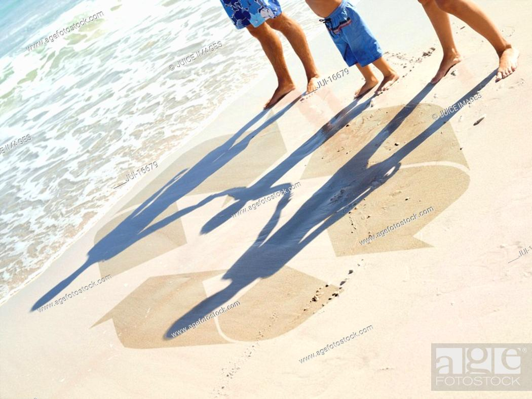 Stock Photo: Family and recycling symbol in sand.