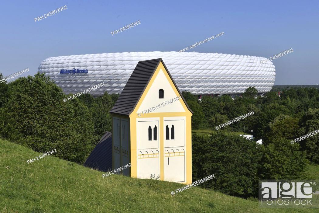 Stock Photo: UEFA EURO 2020 in Munich with spectators! Archive photo :. ALLIANZ ARENA. In the foreground a fake church Heilig Kreuz Church -Timm Ulrichs.