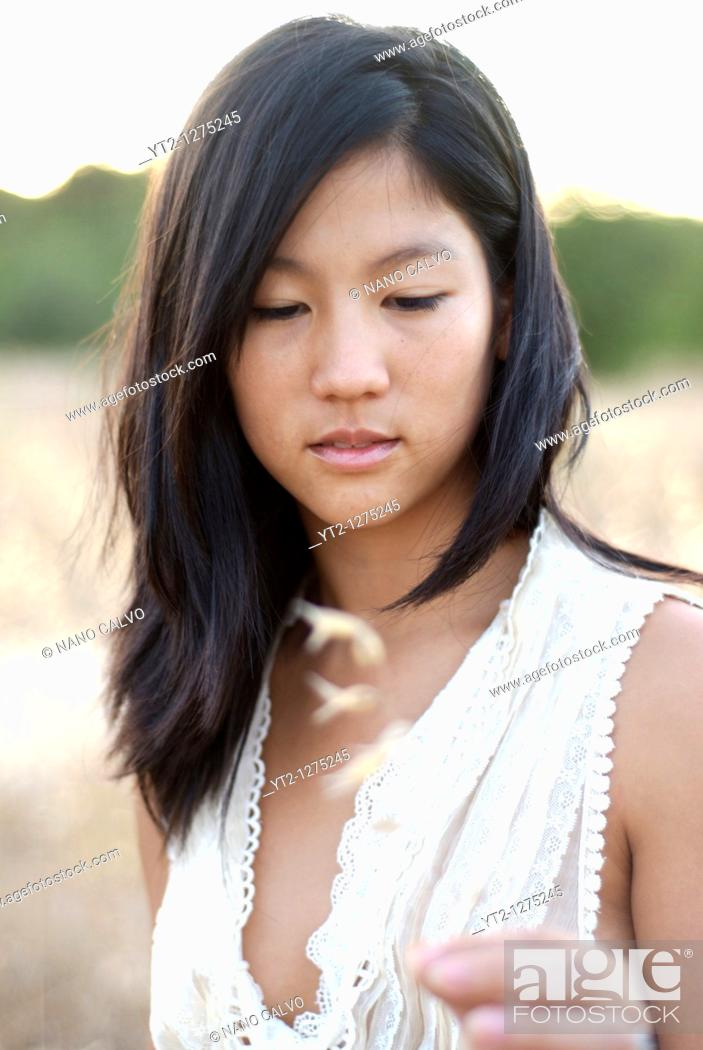 Stock Photo: Portrait of a cute young asian woman.