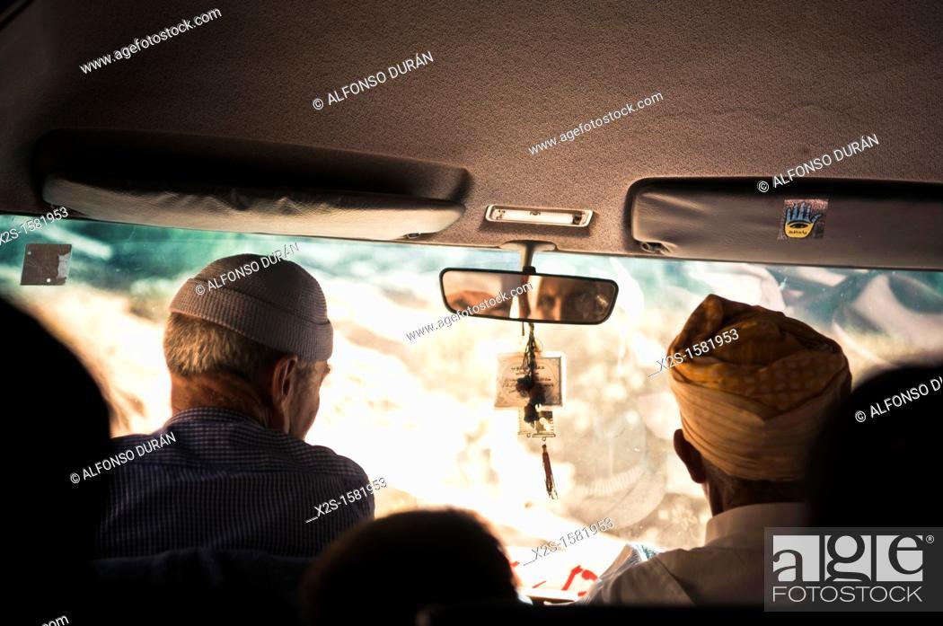 Stock Photo: driver and passenger, Azilal, Morocco.
