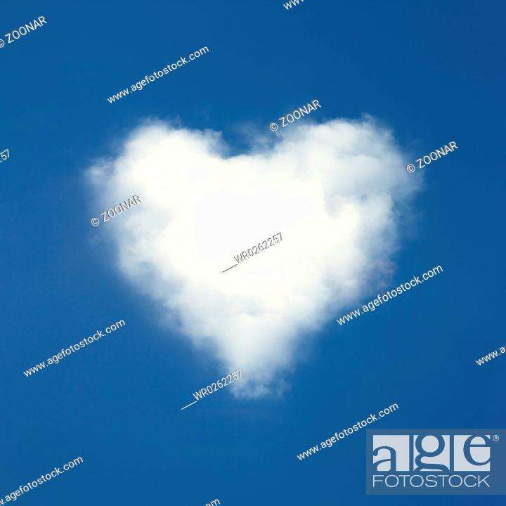 Stock Photo: Heart shaped clouds on blue sky background.