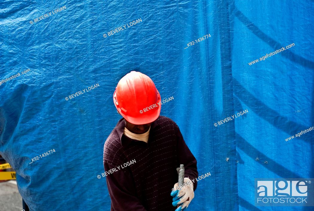 Stock Photo: Man working at a construction site.