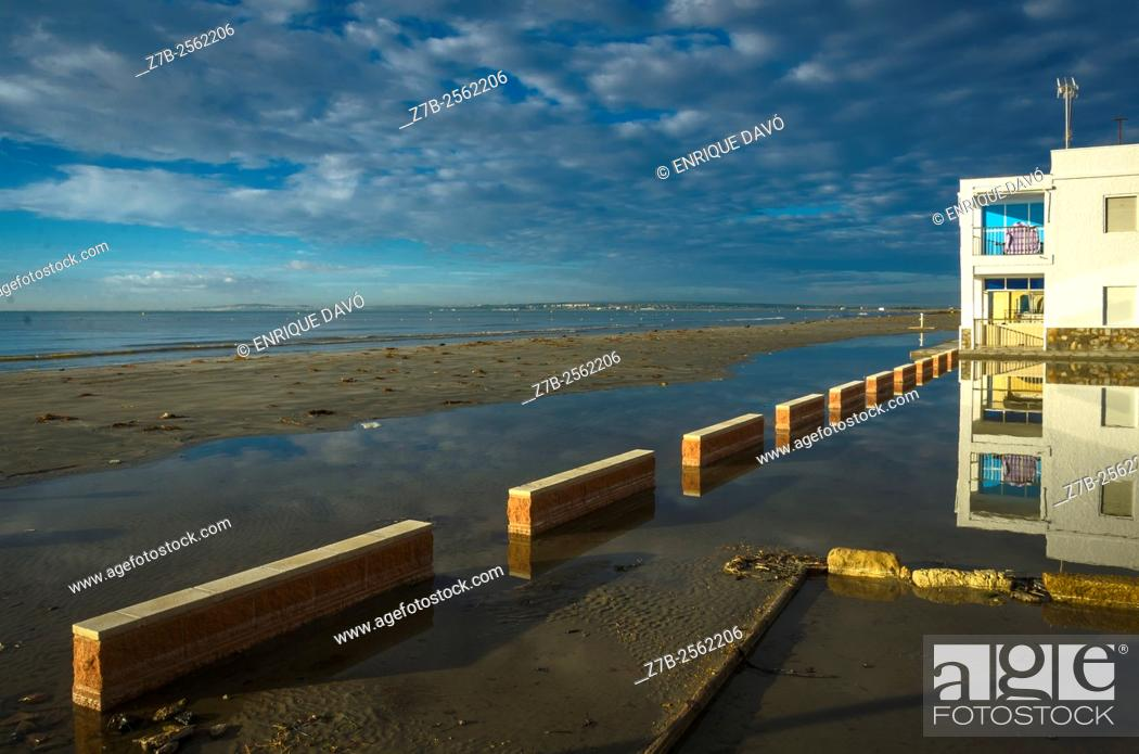 Stock Photo: A reflect view of a building in Playa Lisa beach, Alicante, Spain.
