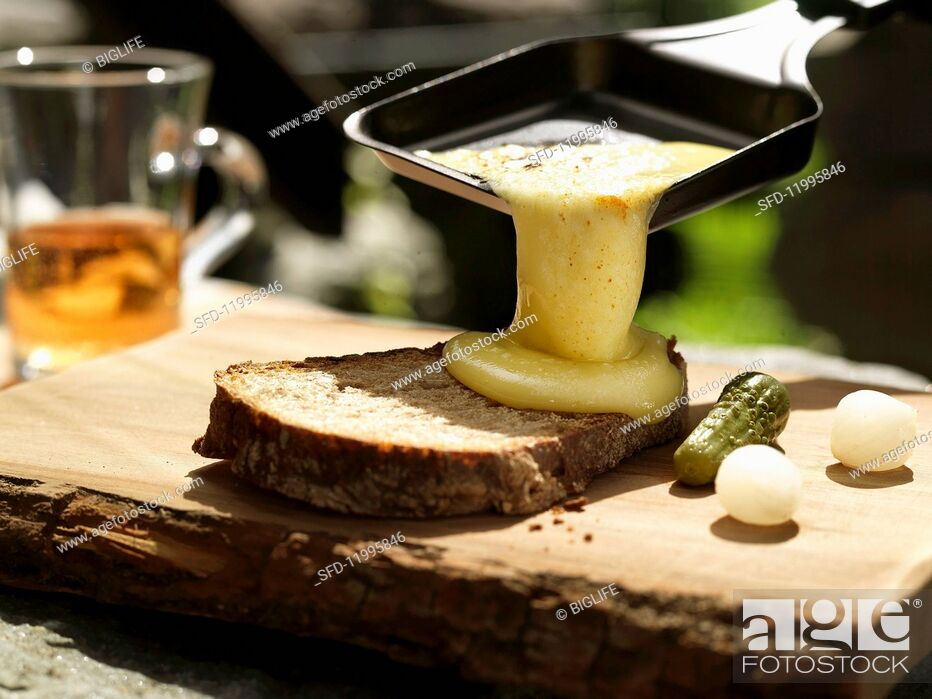 Stock Photo: Raclette with bread, gherkins and pearl onions.