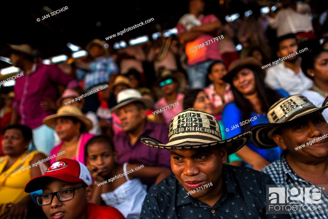 Stock Photo: Colombian peasants, sitting on the bleachers, watch an amateur bullfight in the arena of Corralejas, a rural bullfighting festival held in Soplaviento, Colombia.