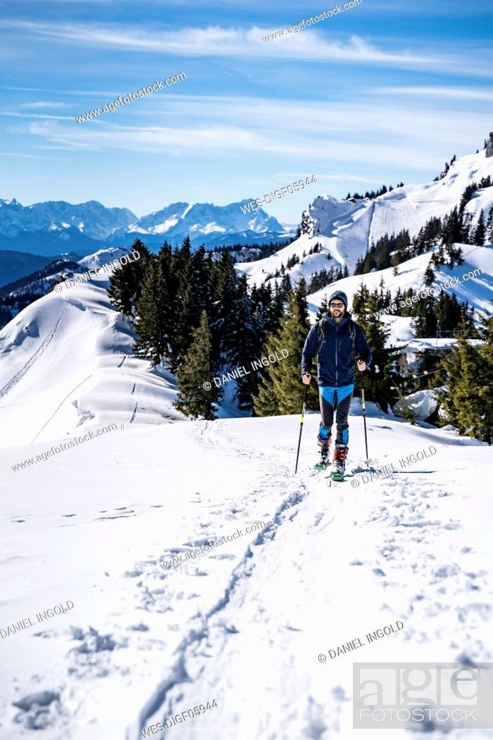 Stock Photo: Germany, Bavaria, Brauneck, man on a ski tour in winter in the mountains.