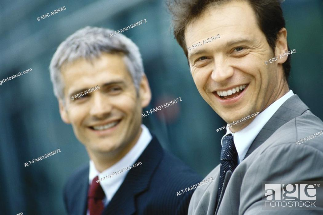 Stock Photo: Two businessmen, head and shoulders, portrait.