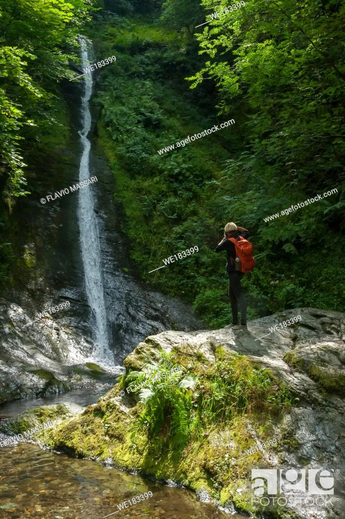 Stock Photo: Young photographer in the Lydford Gorge Natural Reserve, Devon, UK.