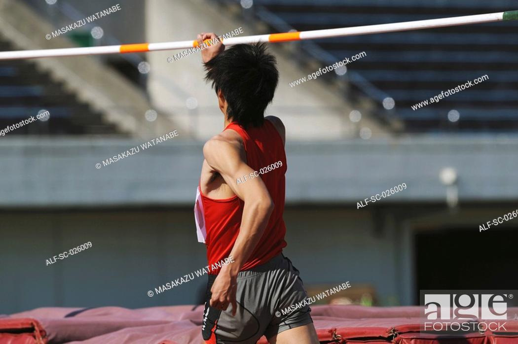 Stock Photo: Athlete Preparing to Jump.