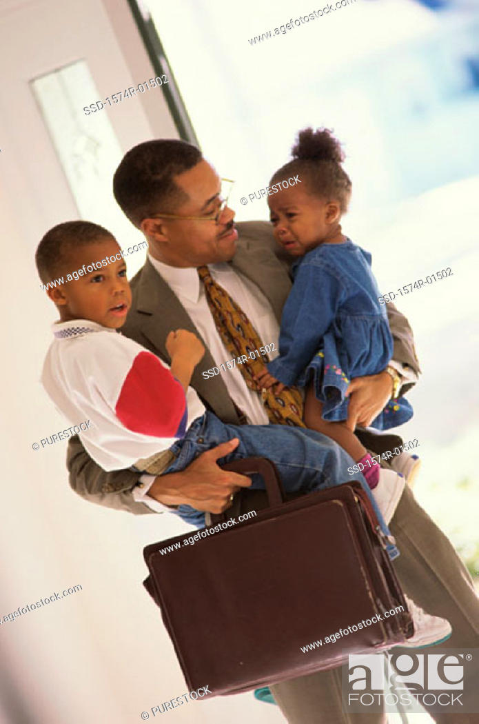 Stock Photo: Businessman carrying his son and daughter.