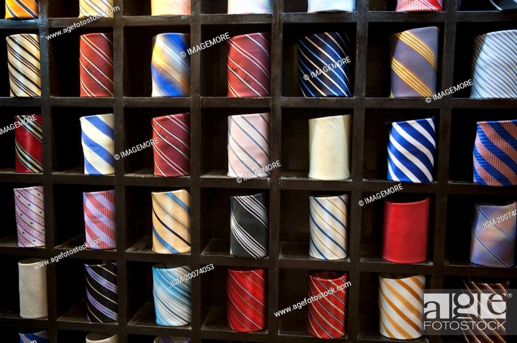 Stock Photo: Ties neatly place in rack.