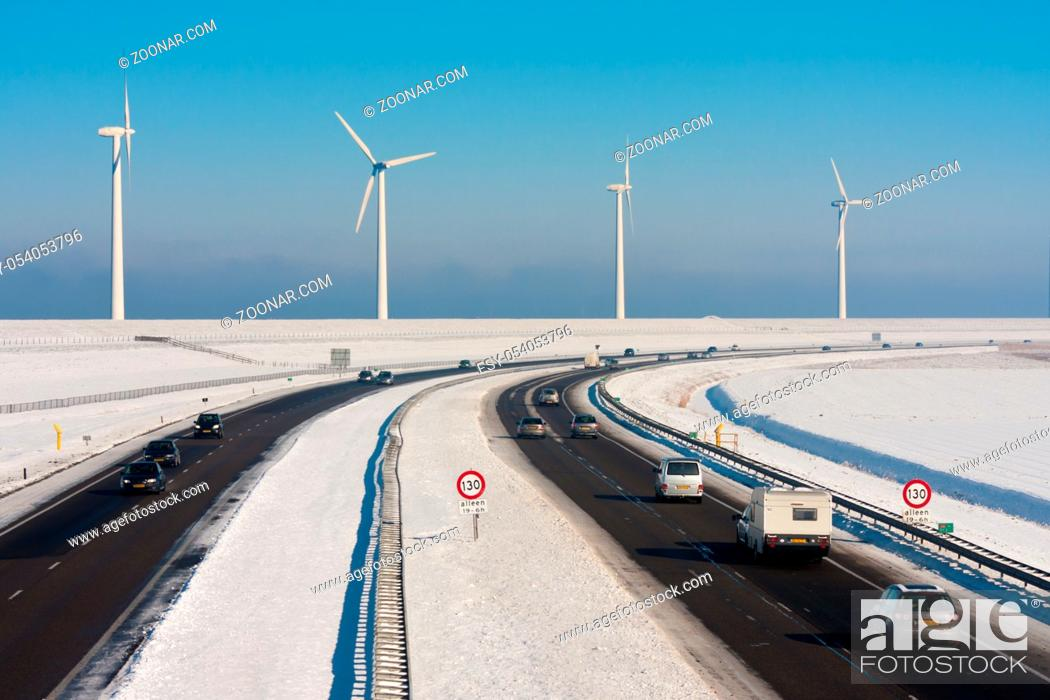 Photo de stock: Dutch rural winter landscape with a highway and big windturbines.