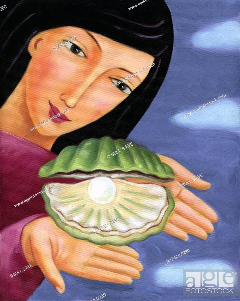 Stock Photo: Closeup of a woman holding an oyster with a pearl inside.