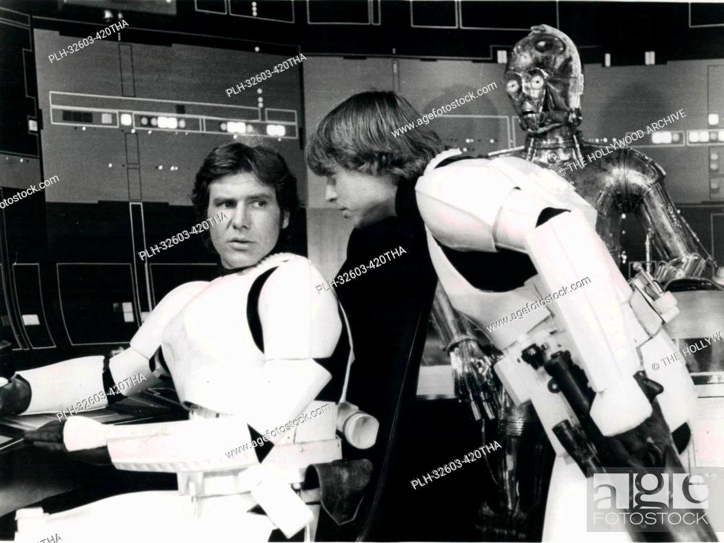 Stock Photo: Han Solo, Luke and C-3PO on set in Star Wars Episode IV: A New Hope (1977).