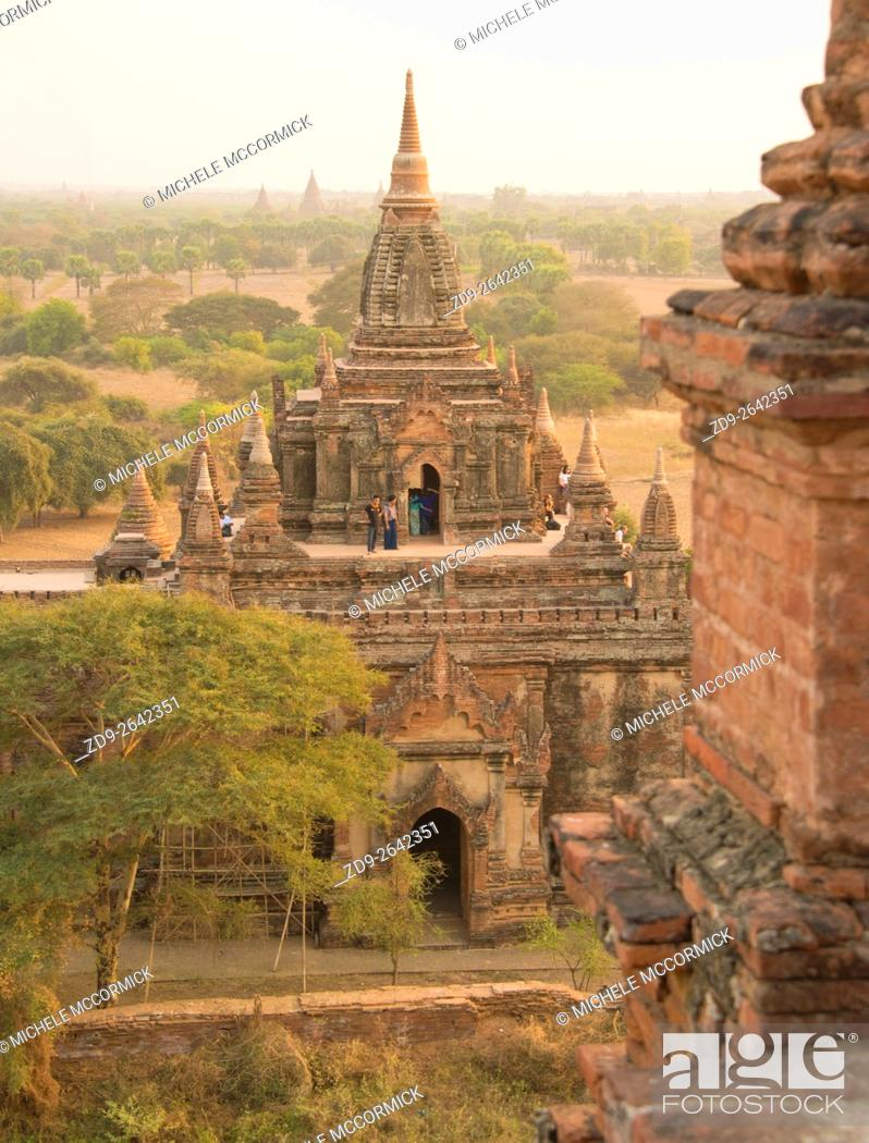 Stock Photo: Details of an ancient Burmese temple at sunset.