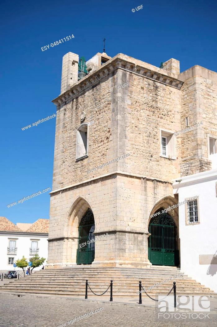 Stock Photo: the clock tower of the Cathedral in the old town of Faro at the east Algarve in the south of Portugal in Europe.