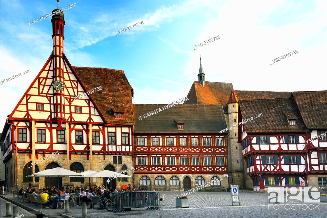 Stock Photo: Half-timbered buildings at Rathausplatz - Town hall square, on left - Rathaus - Town Hall, in background St. Martin church, historic part of Forchheim.