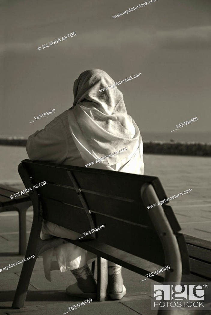 Stock Photo: Muslim woman sitting in front of the sea.