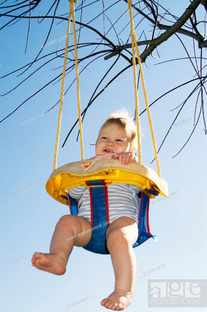 Stock Photo: infant on swing.