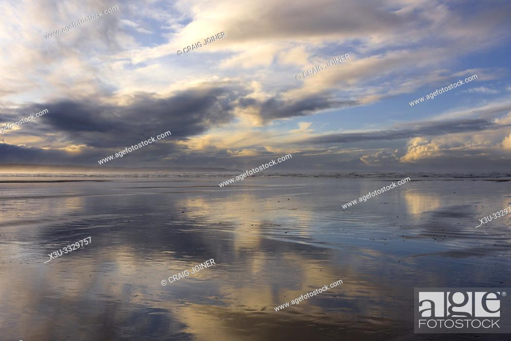 Stock Photo: Clouds reflected in the wet sand at Westward Ho! beach, North Devon, England.