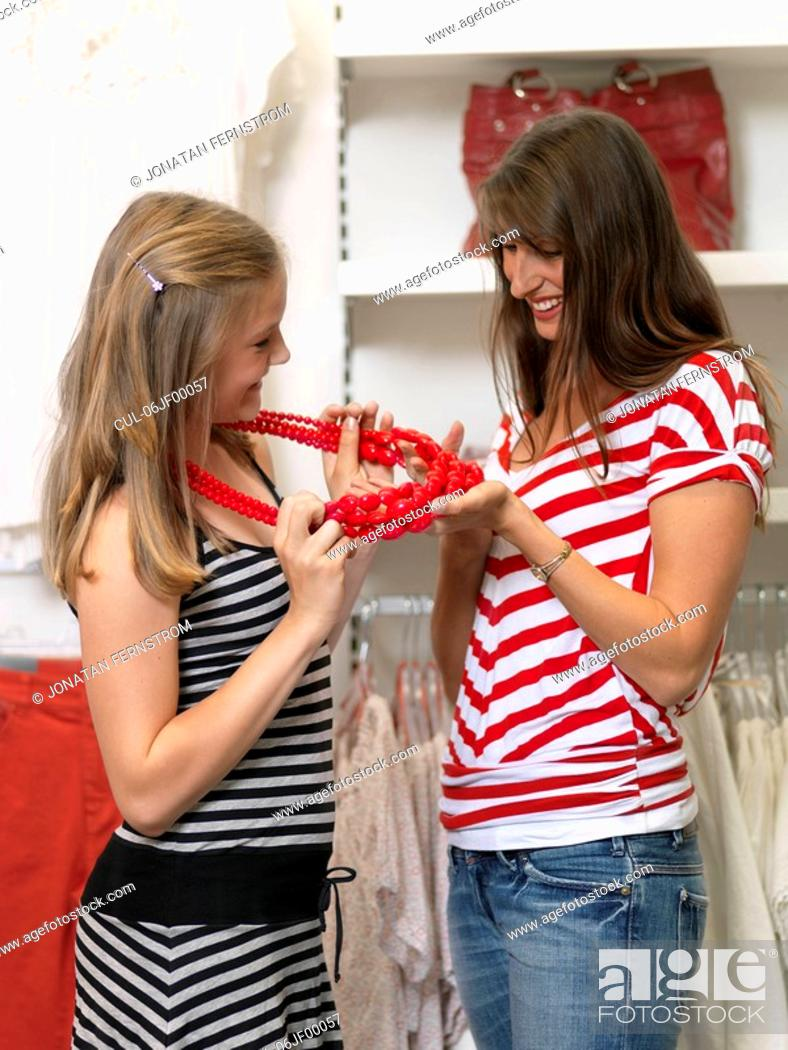Stock Photo: Mother and daughter shopping.