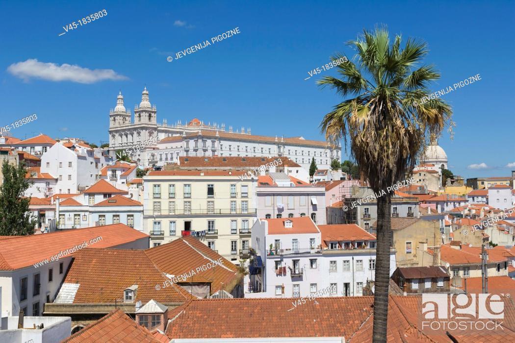 Stock Photo: Terrace Portas do Sol, Gates to the Sun, Largo das Portas do Sol, overlooking the Alfama rooftops with The Church, Monastery of Sao Vicente de Fora, Mosteiro.