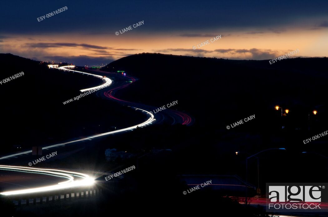 Stock Photo: freeway traffic lights at night in Orange County.