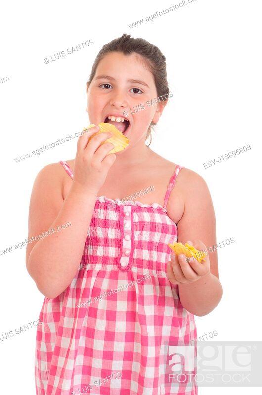 Stock Photo: Girl eating chips.