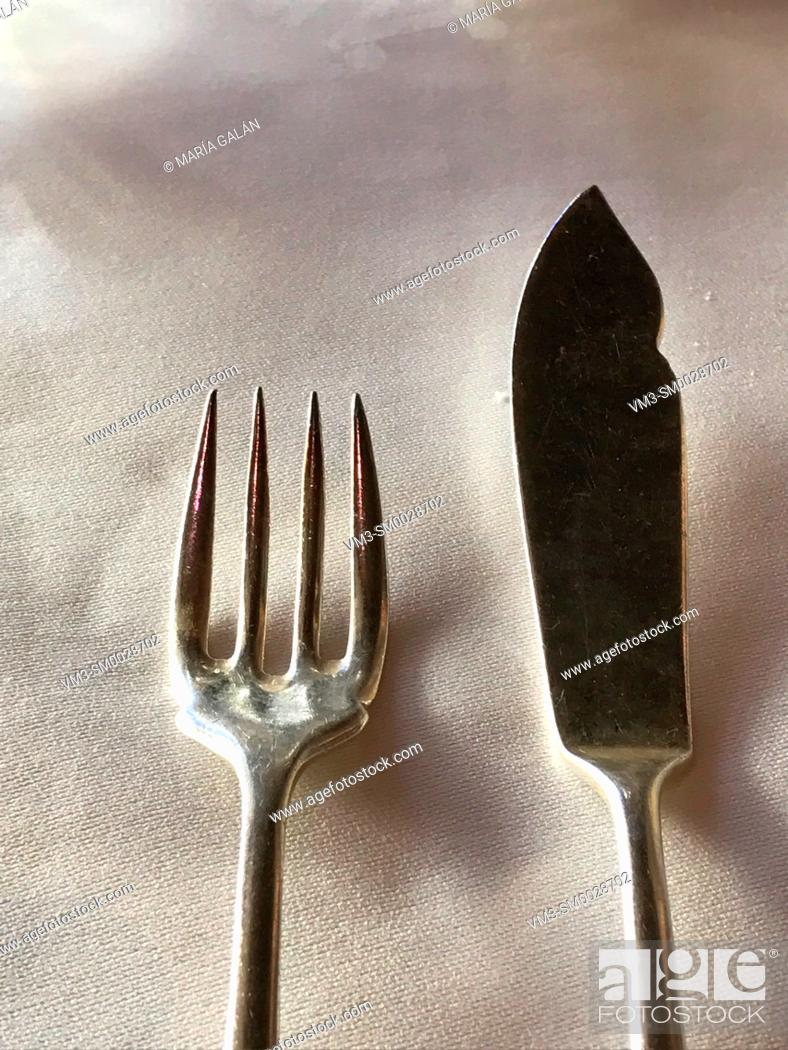 Stock Photo: Fork and knife for fish.
