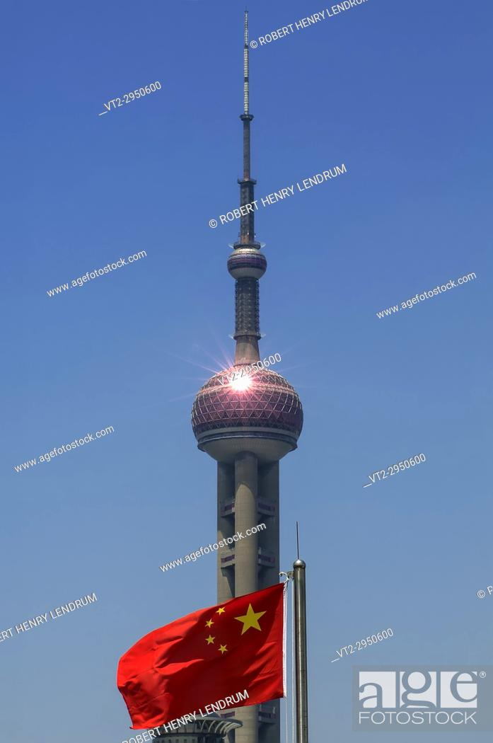 Stock Photo: The flag of the People's Republic of China and the Oriental Pearl Radio TV Tower, Shanghai, China.