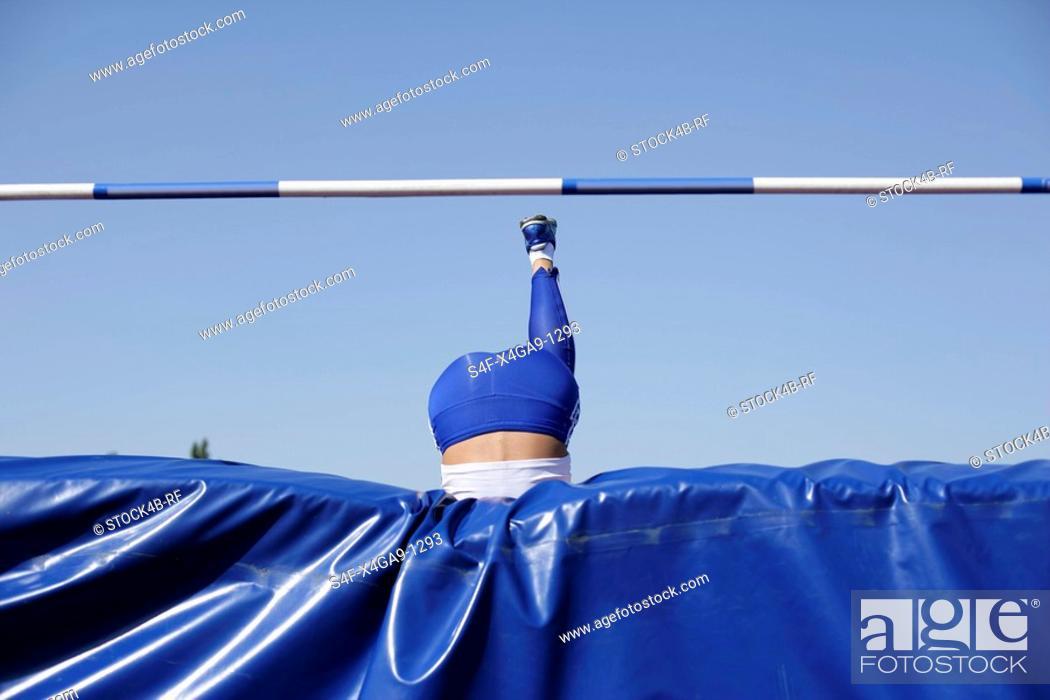 Stock Photo: Woman making high jump.