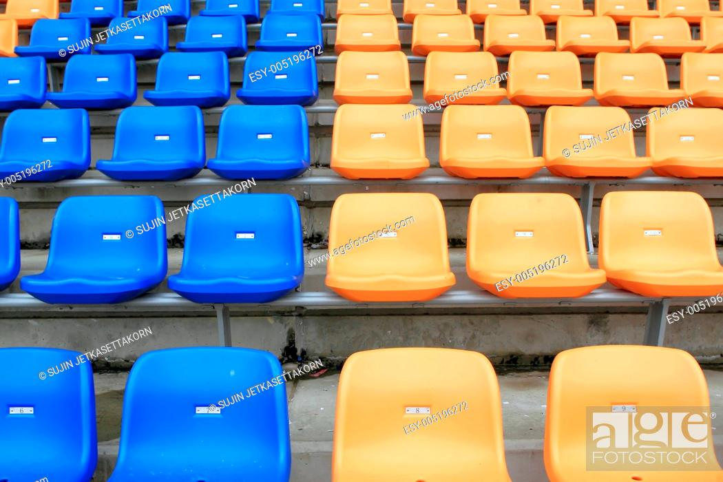 Stock Photo: plastic, yellow and blue, new chairs in stadium.