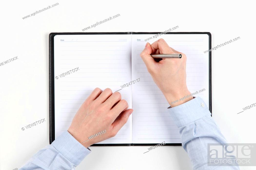 Stock Photo: A man with a pencil in his notebook.