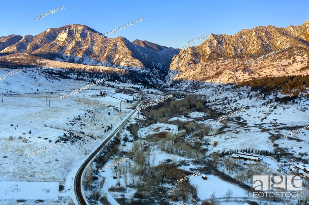 Stock Photo: Aerial photo of the Boulder, Colorado foothills near Eldorado Canyon just after sunrise in winter following an overnight snowfall.