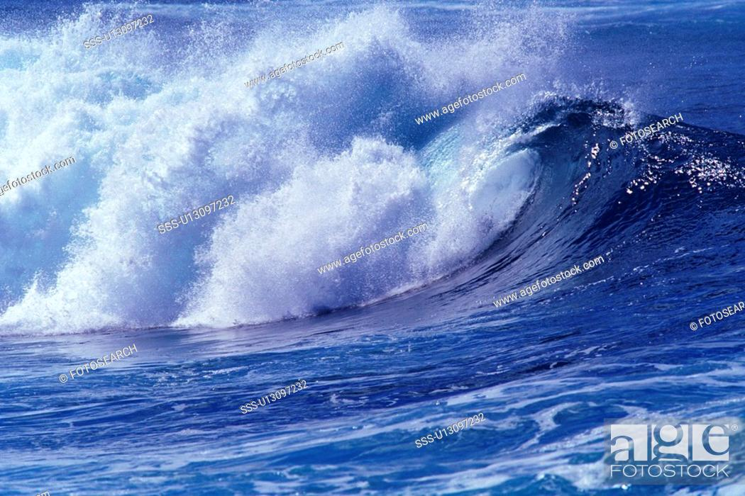 Stock Photo: an Ocean Wave, the Water Splashing in Many Directions, Side View, Hawaii, USA.
