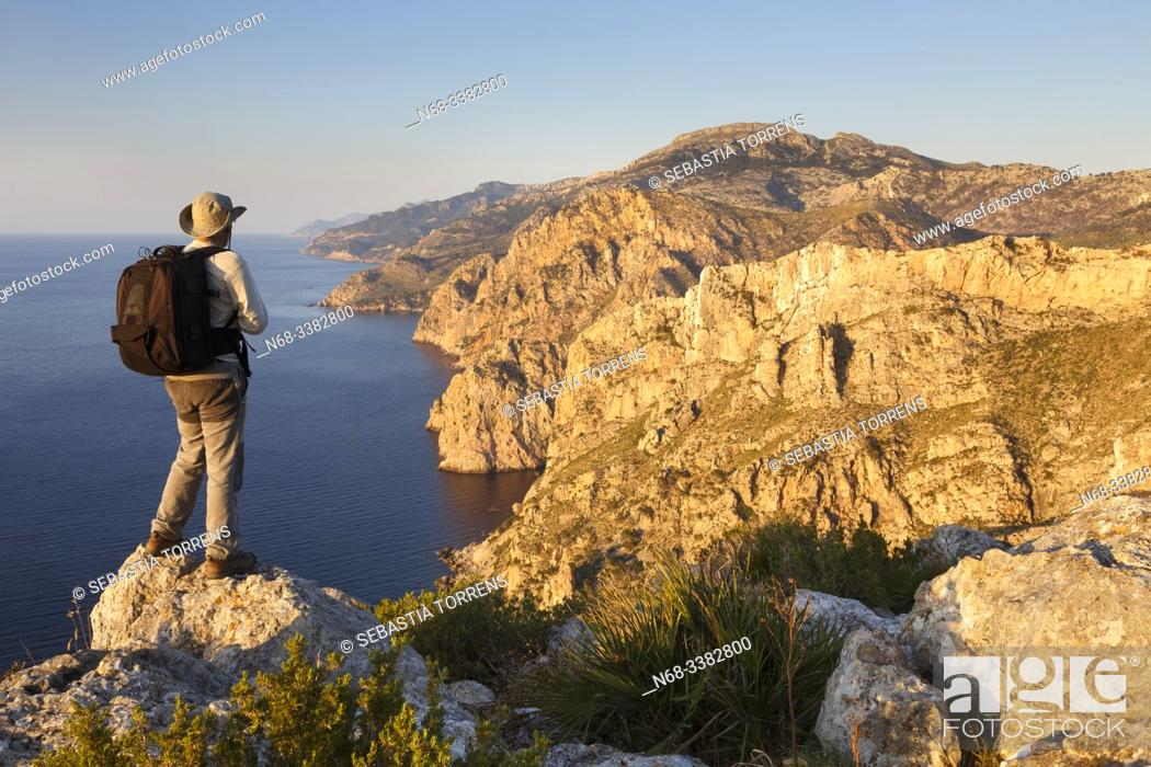 Stock Photo: South sector of the Serra de Tramuntana and S'Evangelica mountain with hiker, Andratx, Majorca, Spain.