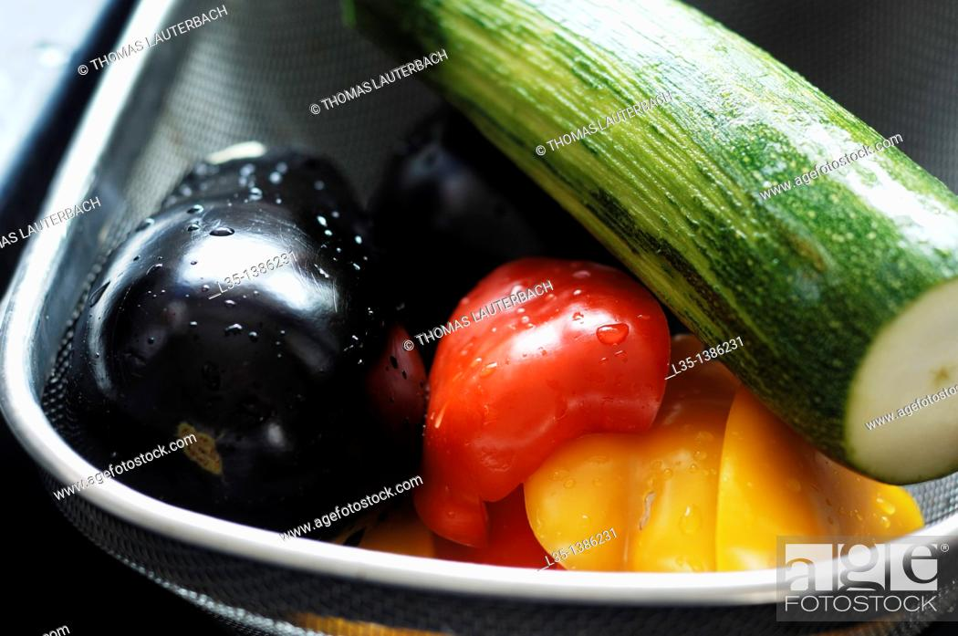 Stock Photo: Freshly washed pepper, eggplant and zucchini in a basket.